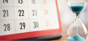 A calendar and an hourglass